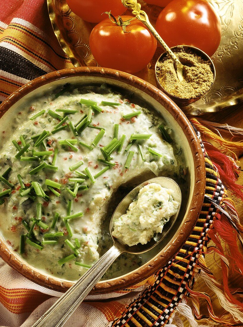 Spoon Scooping Vegetarian Millet From Bowl