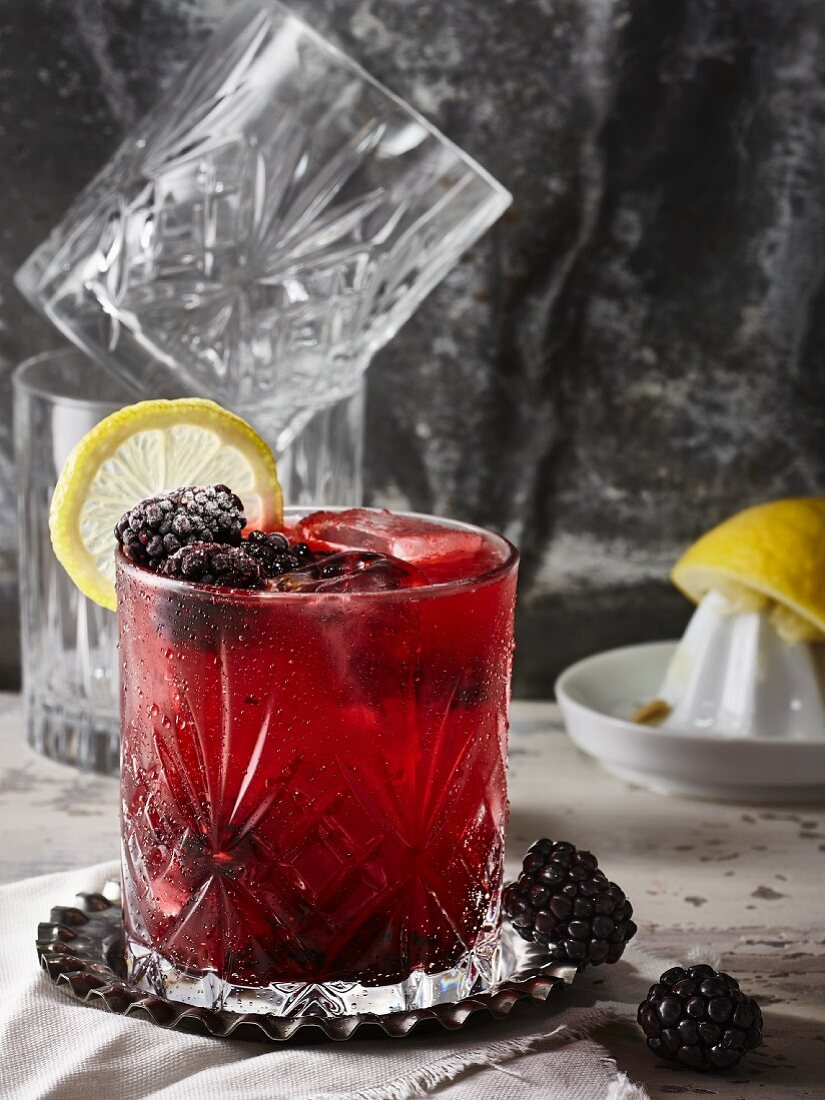 A Bramble cocktail with gin and blackberry liqueur