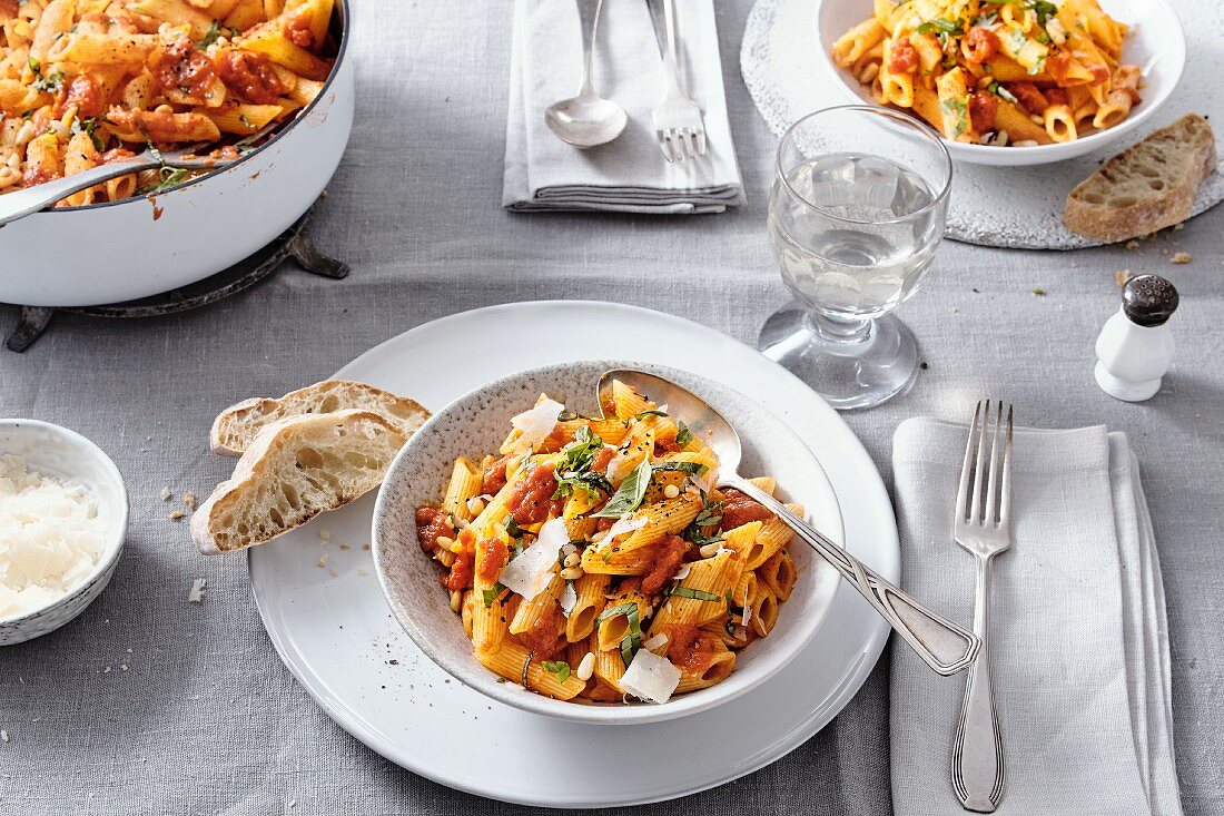Penne with tomato sauce, basil, pine nuts and parmesan