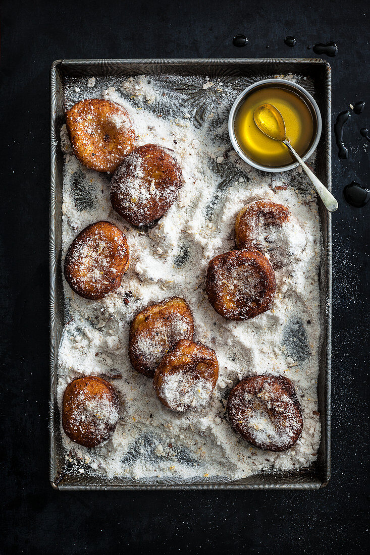 Lemon Fritters tossed in spiced sugar and served with Citrus Honey Syrup