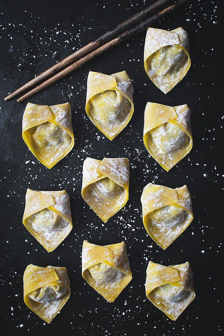 Wontons (stuffed dumplings, China) on a black background