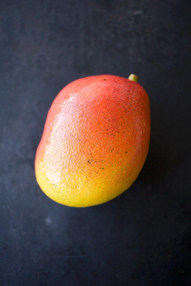 Water drops on a ripe mango