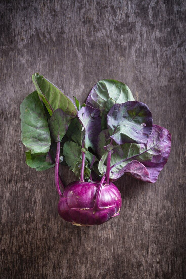 Purple kohlrabi on a wooden background