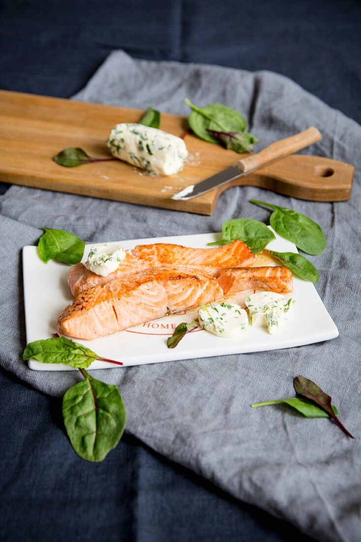 A salmon steak with swiss chard butter
