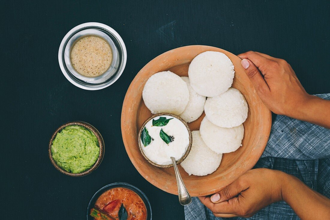 Idli (steamed rice cakes from India) with coriander and coconut chutney