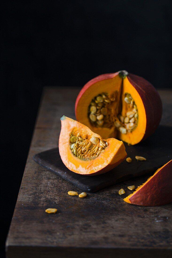 A cut-open pumpkin on a wooden table