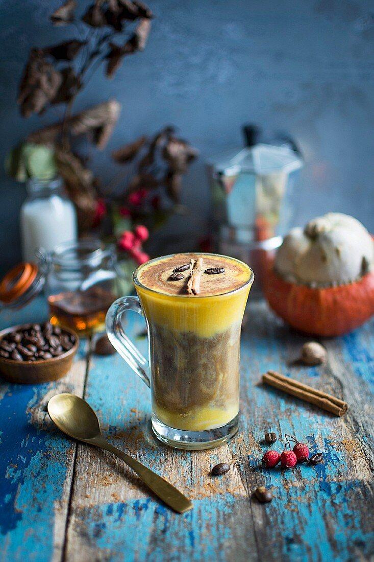 A pumpkin latte with a cinnamon stick