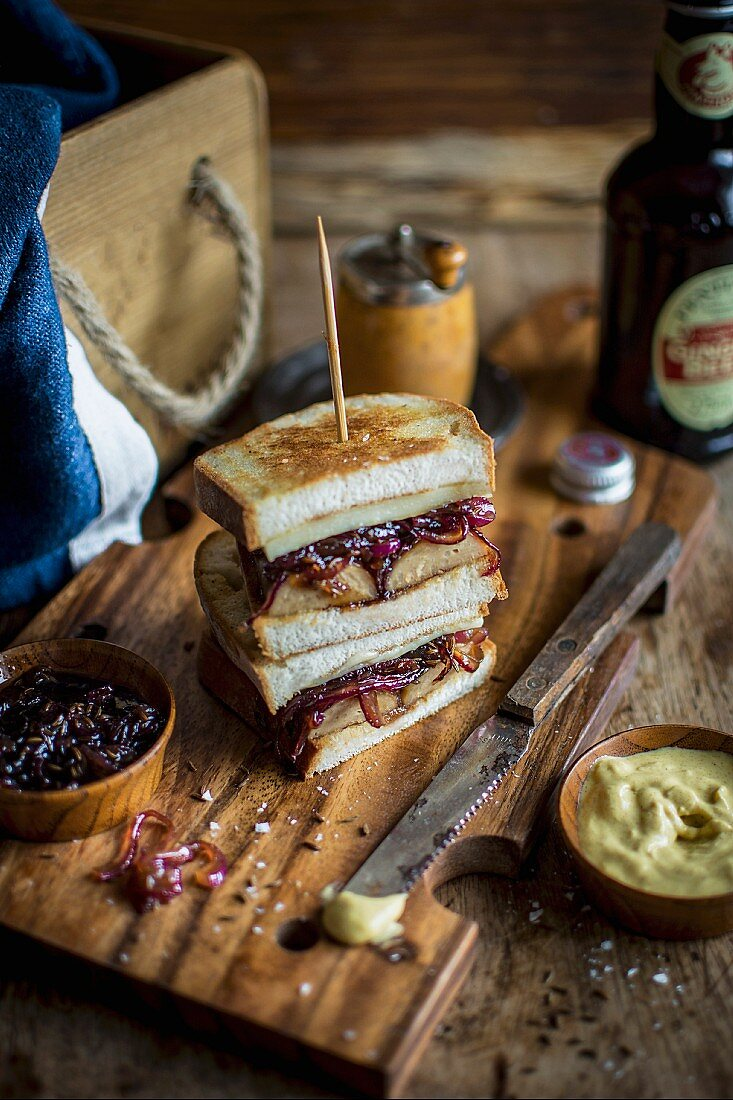 Toasted sandwiches with caramelised red onion, mustard, veggie sausage and cheese