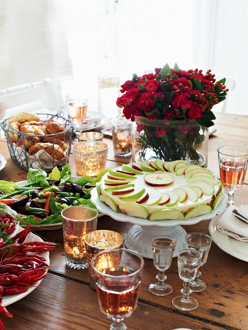 An apple tart on a laid table (Sweden)