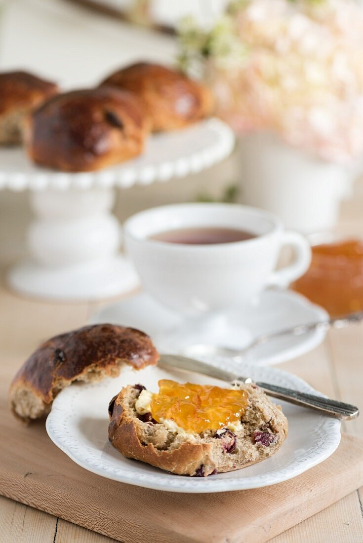 Cranberry and orange teacakes served with a cup of tea