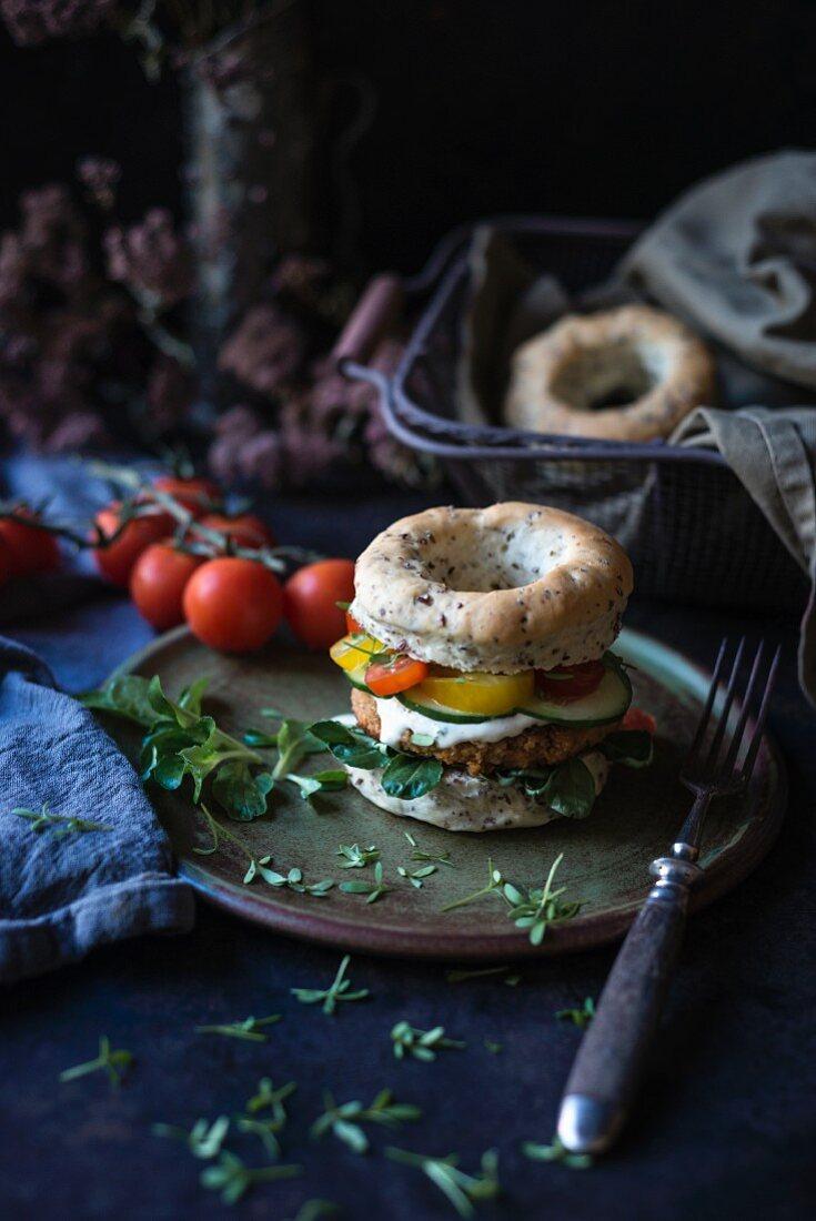 A vegan burger in a linseed bagel
