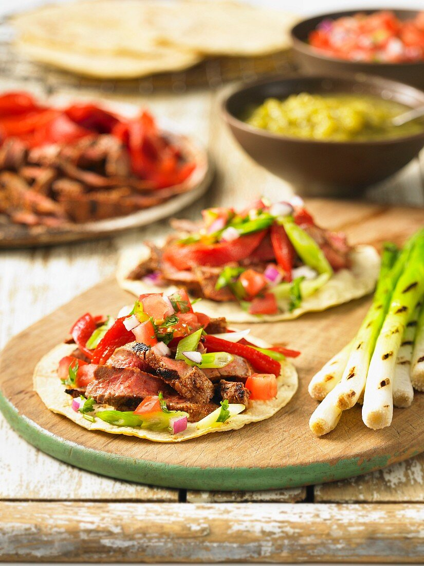 Beef fajitas with red pepper and spring onion
