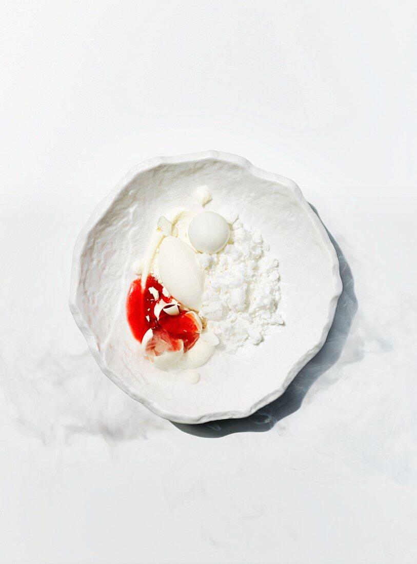 Milk crumbs with yoghurt and orange blossom ice cream, strawberries, lime and white chocolate