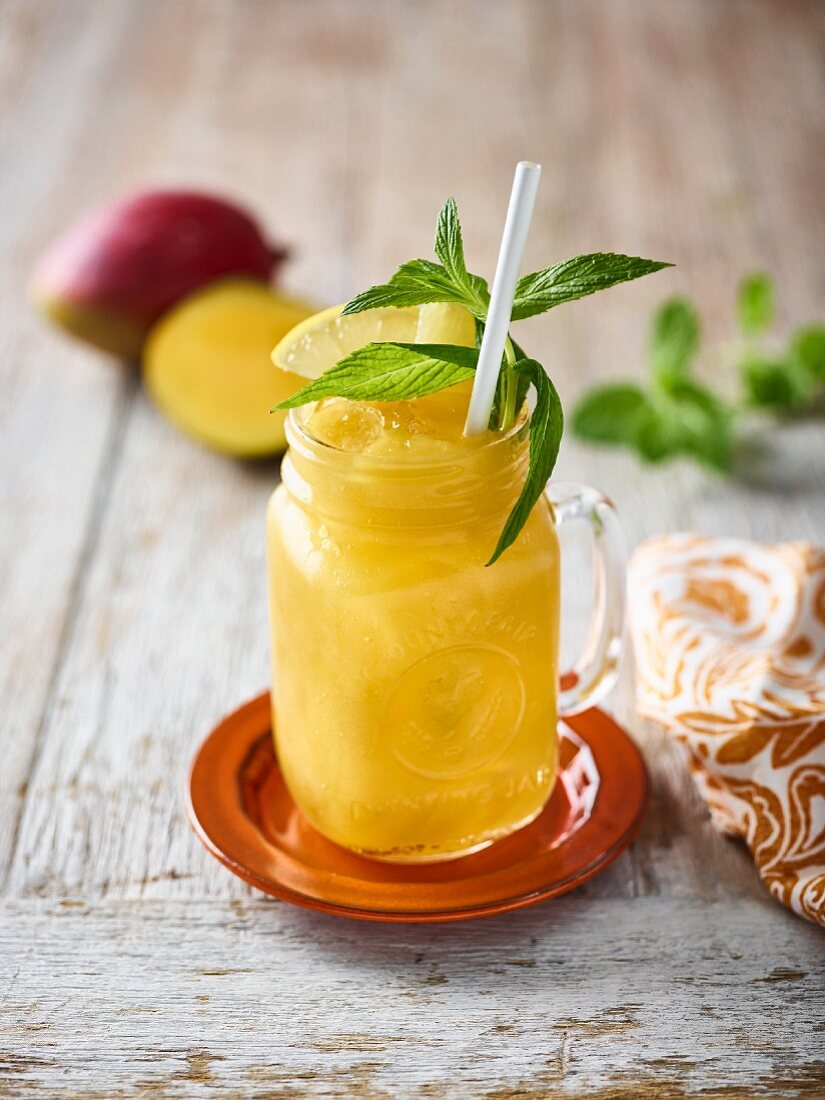 A mango smoothie with mint and lemon