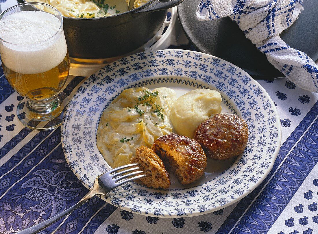 Meat balls with mashed potato and braised cucumber