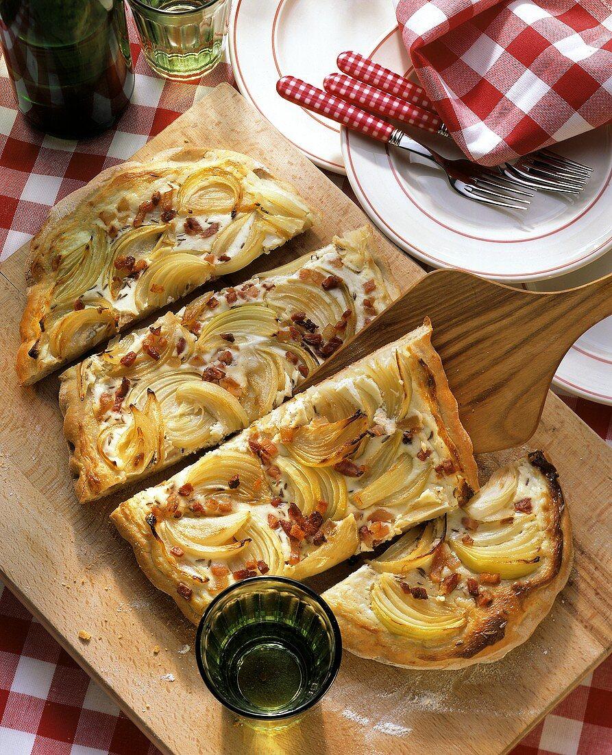 Alsatian tarte flambe (tray-baked onion & bacon quiche)