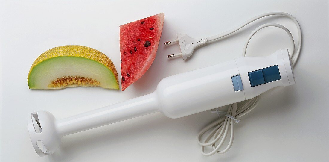 A Hand Blender with Slices of Melon