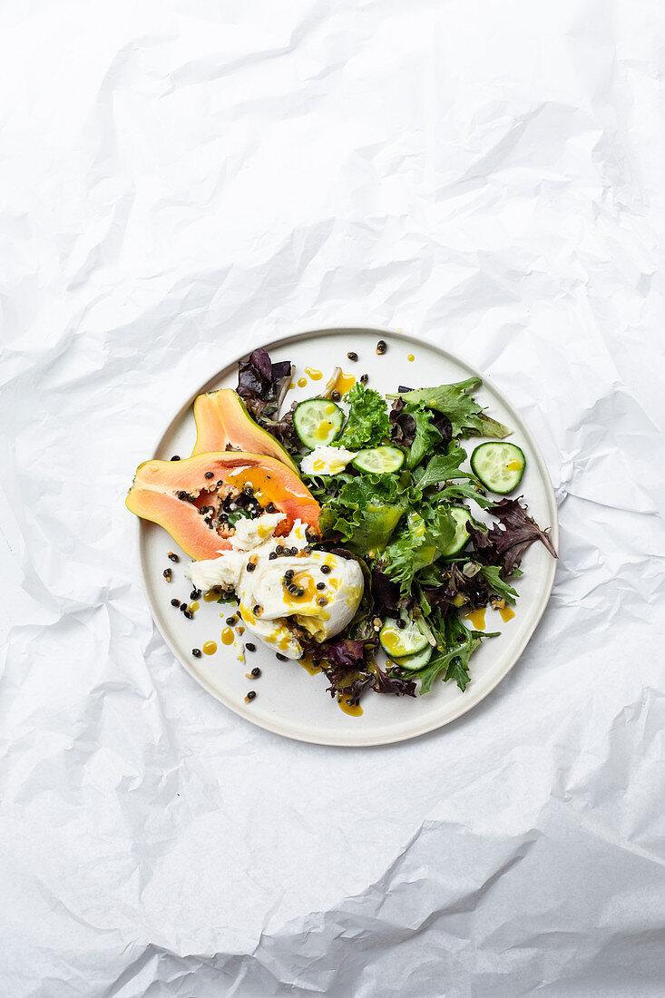 Salad leaves with buffalo mozzarella and papaya