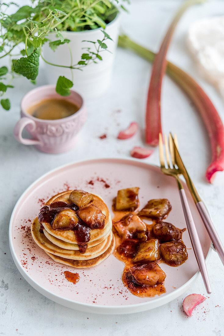 Pancakes with caramelized rhubarb, sprinkled with strawberry powder