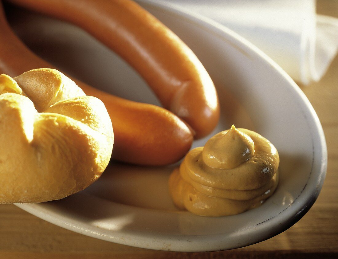 Two Hot Dogs with Mustard on a Plate