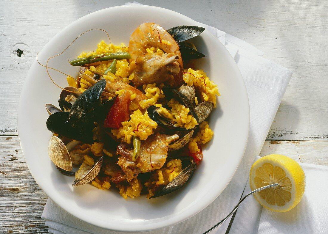 A Dish of Paella; Lemon Half