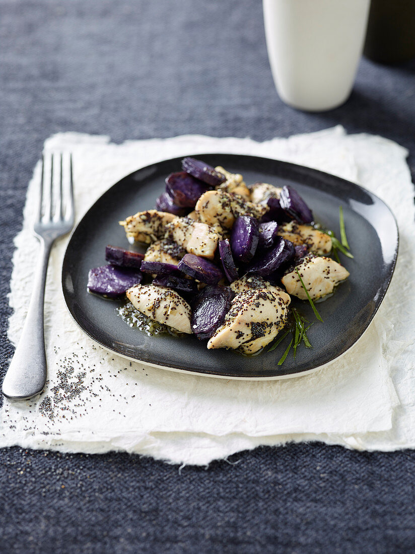 Poppyseed and ginger chicken with purple potatoes