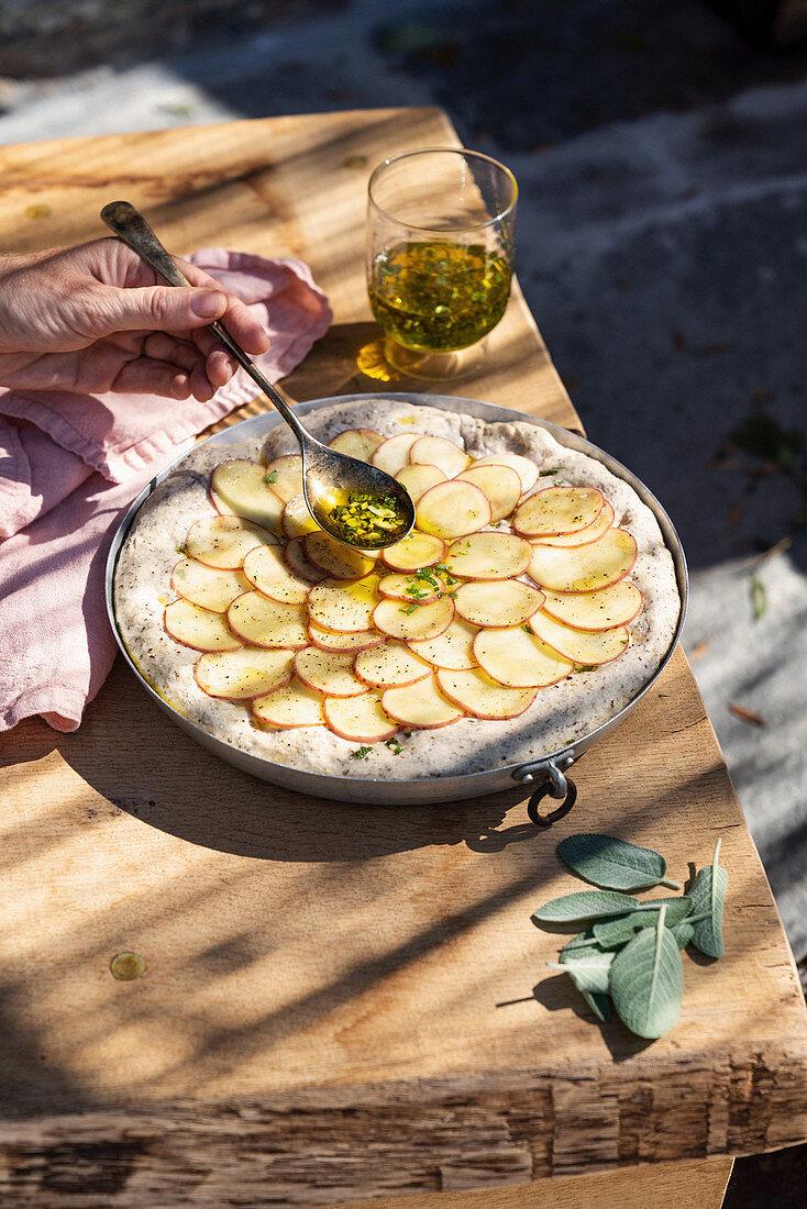 Preparing buckwheat focaccia with potatoes and sage