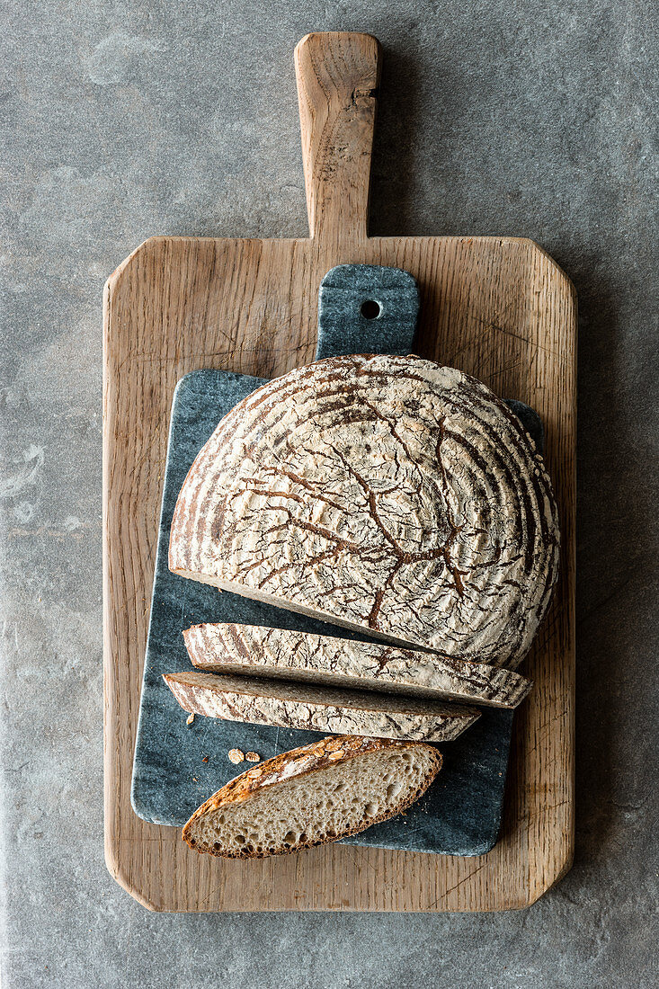 Spelt and flake bread, sliced on a wooden board