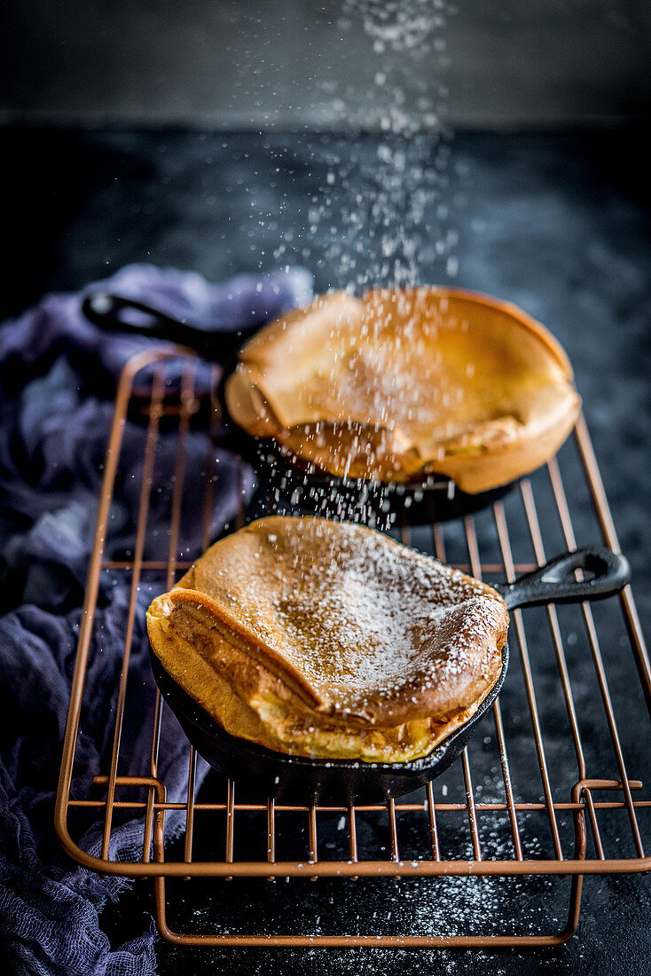 Baked pancakes sprinkled with powdered sugar