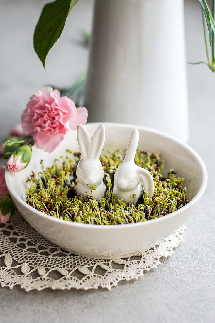 Spring cress in a bowl with Easter bunnies