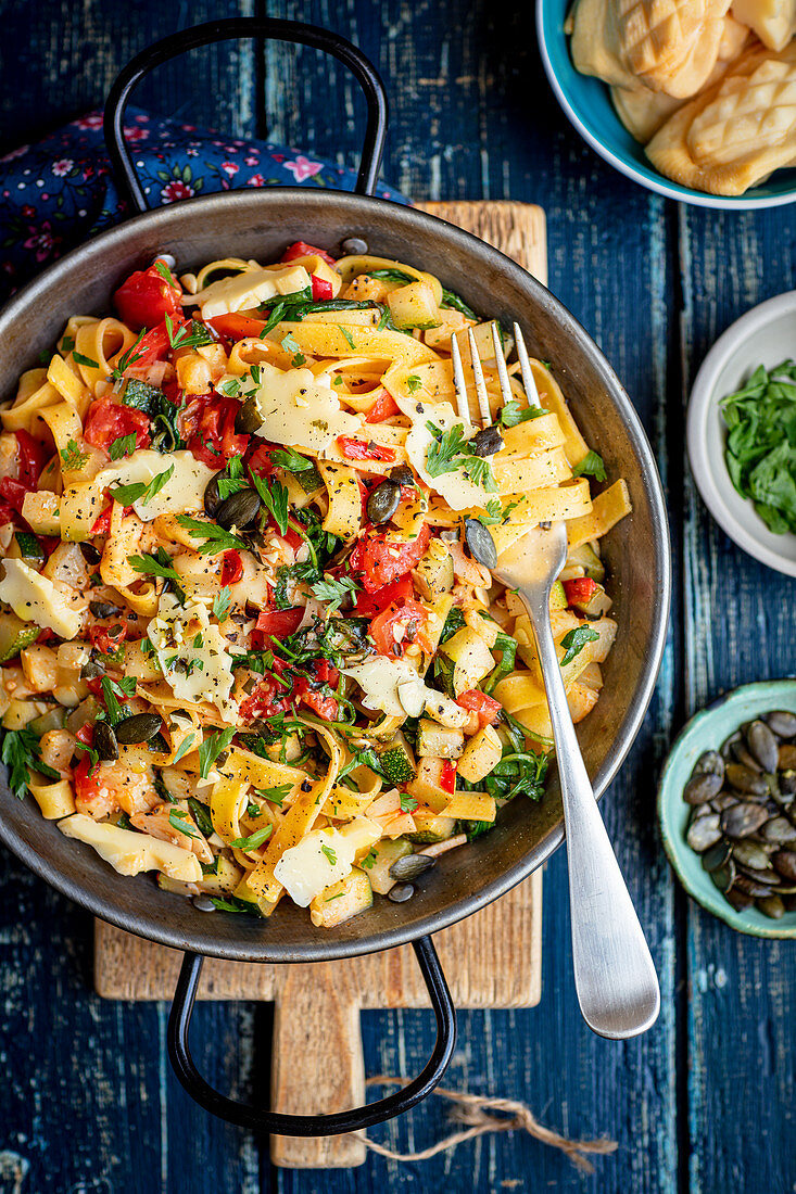Tagliatelle with tomatoes rocket and smoked sheep cheese (oscypek)