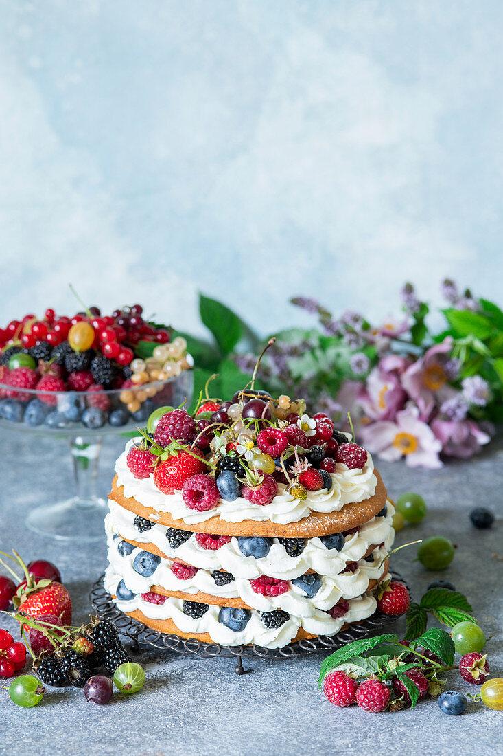 Honey layer cake with cream cheese and berries