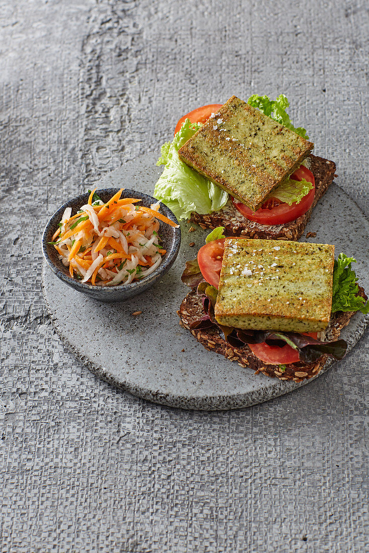 Vegetarian tofu slices with raw vegetables