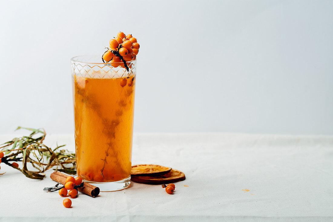 Warm sweet organic tea with sea buckthorn berries, thyme and honey