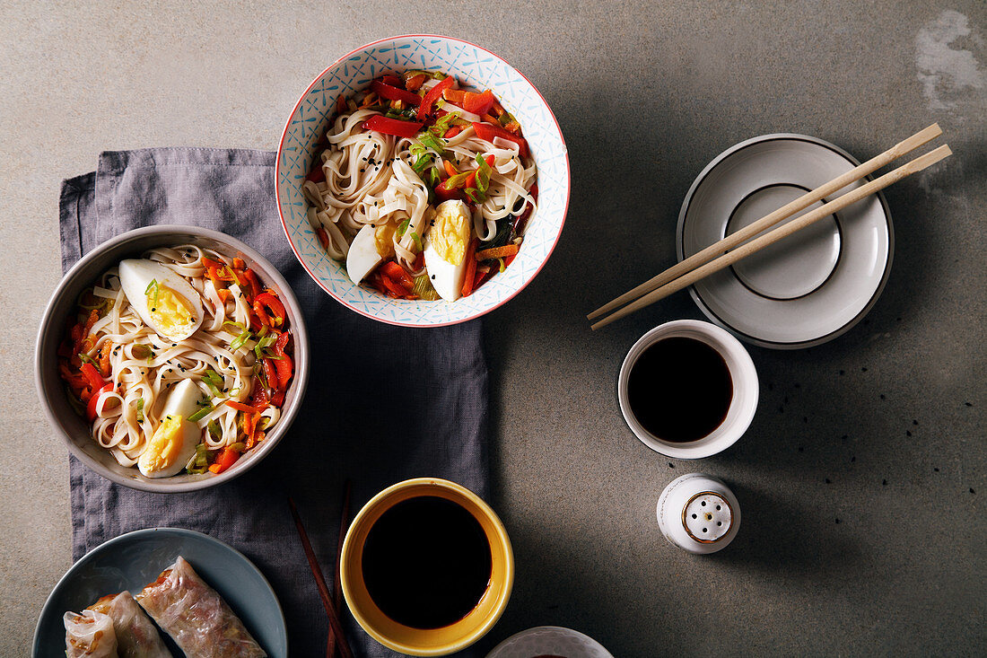 Lunch with udon noodles with vegetables and spring rolls