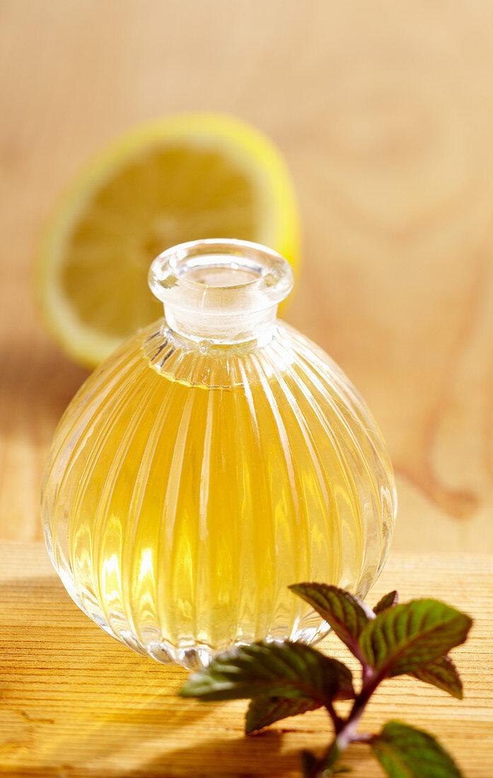 Homemade peppermint and lemon vinegar in a glass bottle