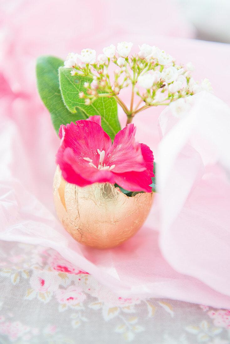 Flowers in vase made from gilded egg shell