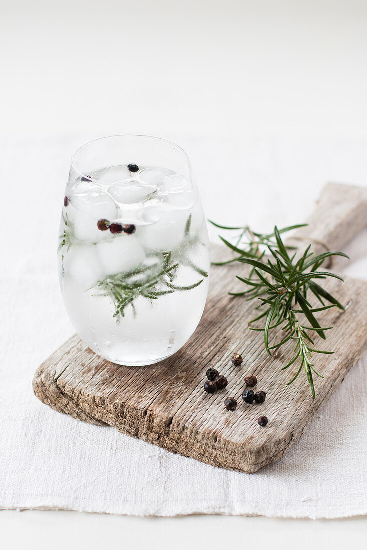 Gin and tonic with rosemary twig and juniper berries