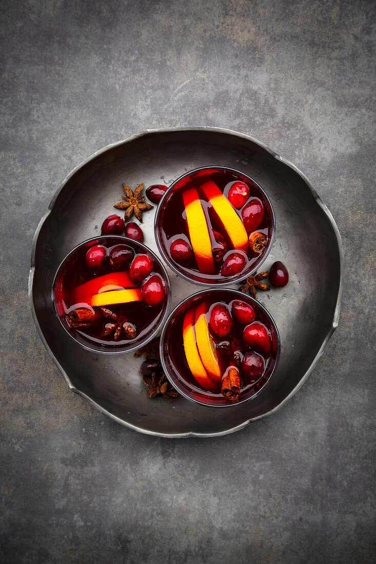 Mulled wine with cranberries, cinnamon, orange slices and star anise