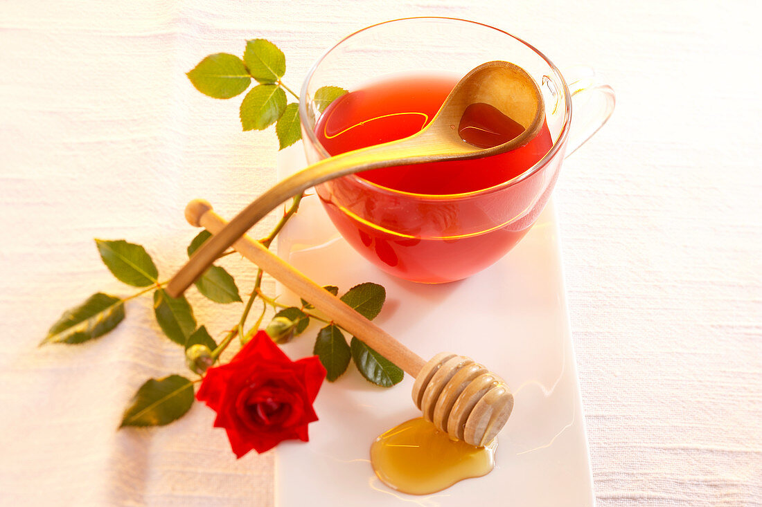 Homemade rose vinegar in a glass cup with acacia honey