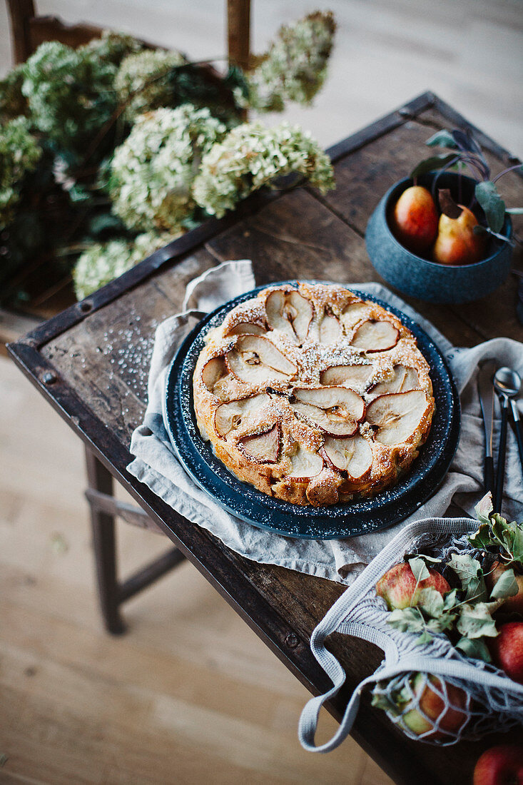 Autumnal pear cake on a rustic wooden table