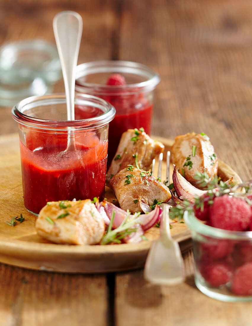 Homemade raspberry and ginger ketchup with suckling pig fillets