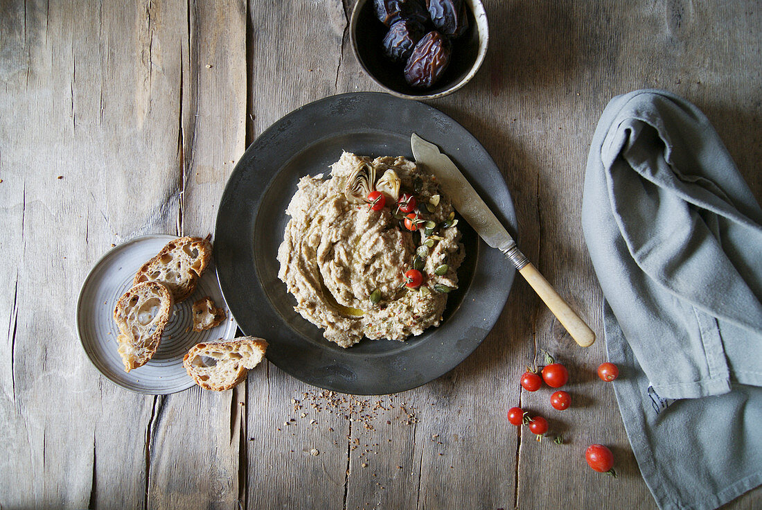 Artichoke dip served with cherry tomatoes