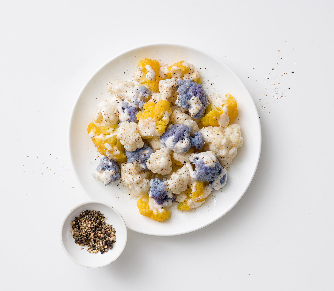 Colourful cauliflower florets with pecorino and ground pepper