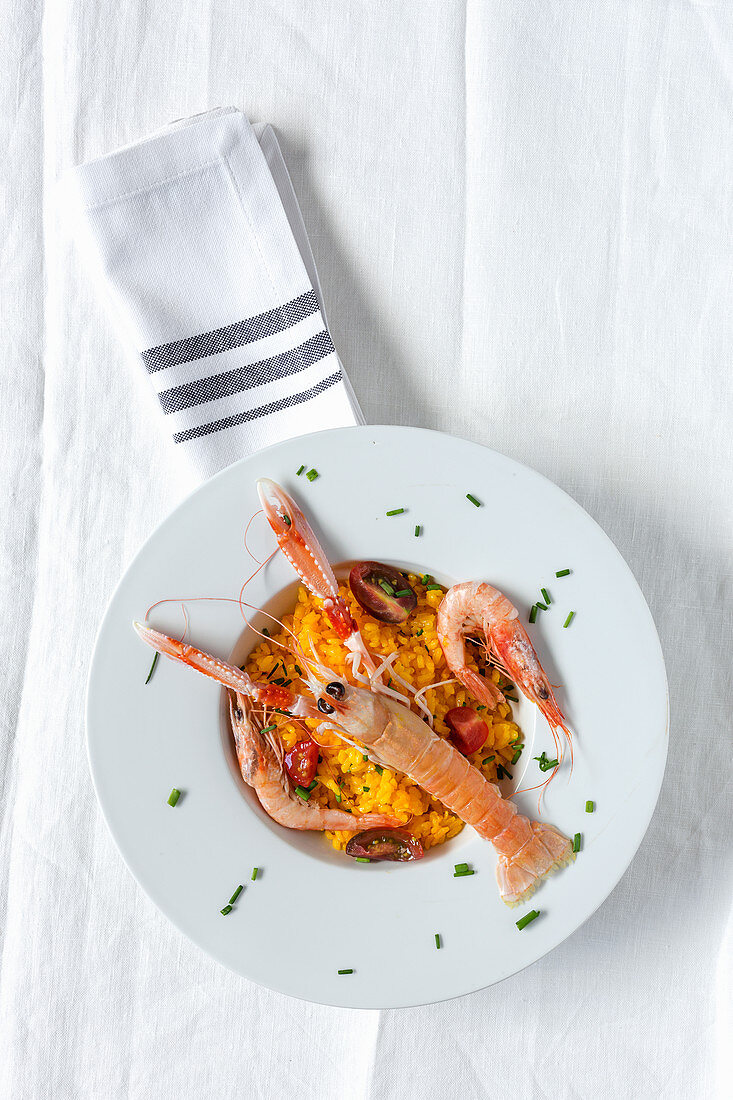 Homemade rice with crayfish and prawns on white background