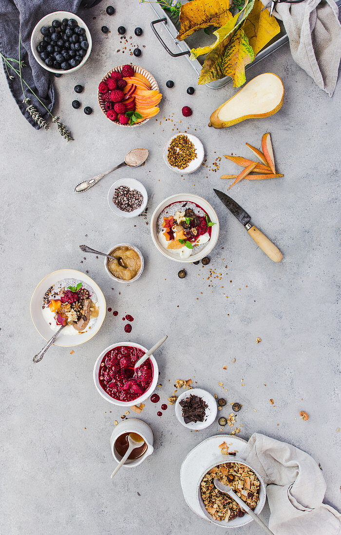 From above shot of delicious chia parfait and various fruits and grain lying on marble tabletop