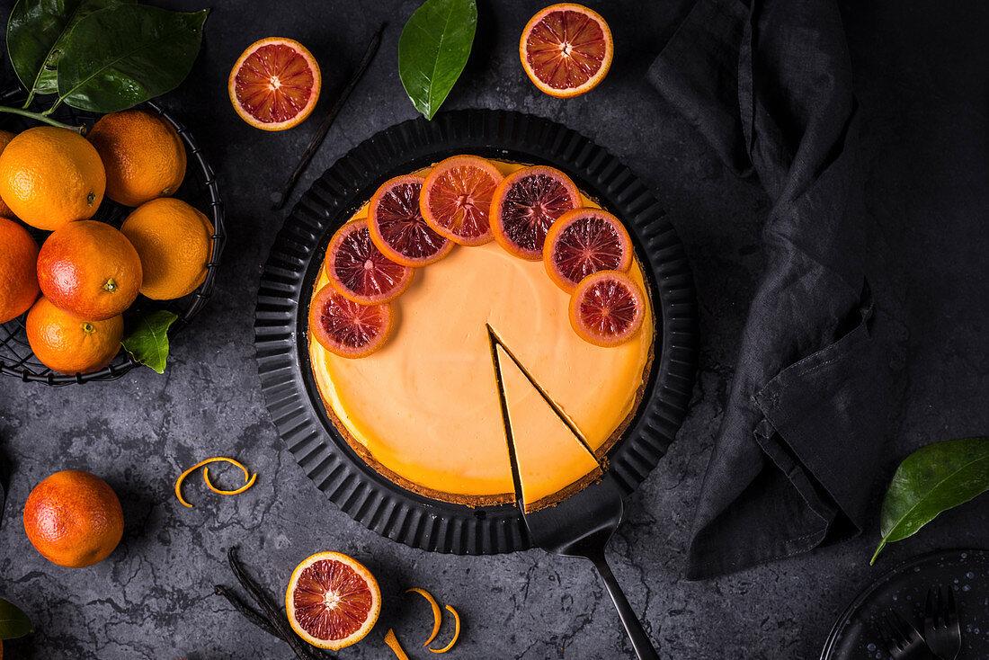 Blood orange cheesecake on a dark background