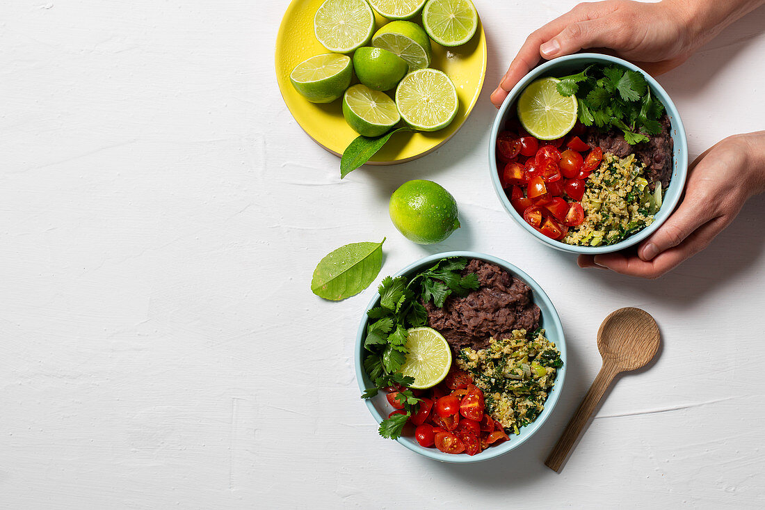 Vegan bowl with cruciferous rice, smashed black beans and baby tomatoes
