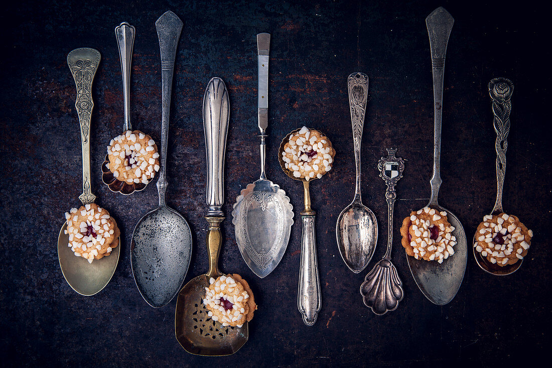 Biscuits with marmalede filling on vintage spoons