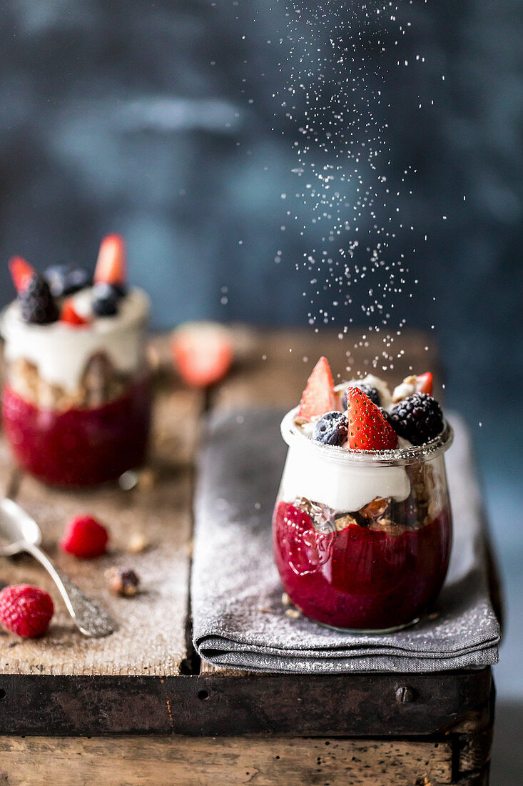 Granola layered with fruit puree and yogurt
